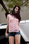 Teen cutie Alyson Grey posing non nude in short denim shorts outside