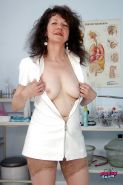 Mature gyno nurse in stockings stuffing her unshaven twat with a speculum