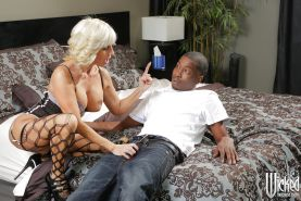 Mature pornstar Tara Holiday is having an interracial sex