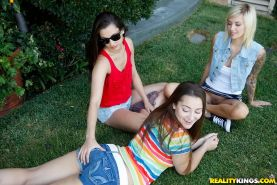 Pretty blonde babe with shaved slit Emma Mae has some lesbian fun outdoor