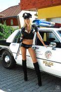 Blonde bombshell in police uniform stripping and toying her cunt outdoor