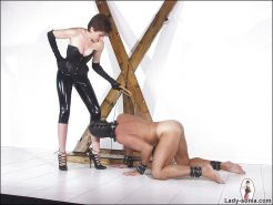 Filthy femdom in latex outfit torturing her manslave's cock