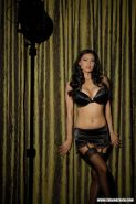 Hot Asian MILF Tera Patrick modeling in tease fashion on bed in sexy lingerie