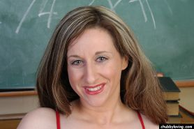 Mature woman Kitty pulls red blouse down and undresses in classroom