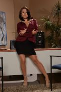 Short Latina secretary Eva Angelina flashing leg and hose at work