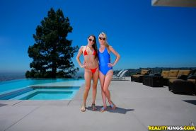 Young lesbian babes in bikini kissing and licking twats near the pool