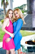 Clothed lesbians Sadie Blair and Sandy Fantasy hump in high heels