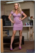 Stunning MILF Brandi Love getting naked and spreading her long legs