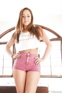 Sexy brunette Remy LaCroix in shorts spreading legs to reveal shaved pussy