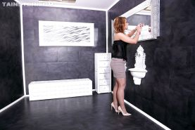 Fully clothed redhead in heels gets covered in cum in gloryhole bukkake
