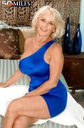 Busty mom in a blue dress Georgette Parks getting cum all over her mature tits