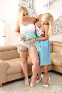 Buxom blonde lesbians Dolly Fox and Kyra Hot lick each others pussy