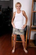 Top-heavy blonde MILF Brooke Tyler undressing and toying her bald gash