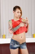 Babe with tattoos Catherine Sand spreads pussy and pisses right on her belly