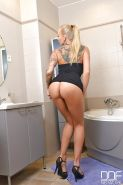 Leggy blonde Euro babe Kayla Green flaunting tight ass in bathroom