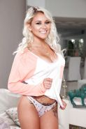 Young and busty blonde girl Marsha May unleashing nice teen breasts