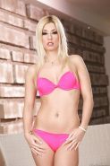 Slim blonde in pink lingerie Jessie Volt uncovering her titties and sexy ass
