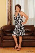 Lascivious granny in glasses has no lingerie under her dress