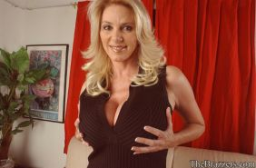 Busty mom Penny Porsche strips to stockings and teases her twat