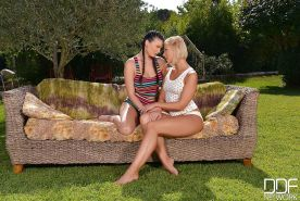 Busty European lesbians Lucy Li and Tracy Lindsay remove panties outdoors