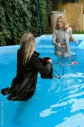 Tatiana Milovani has some fully clothed fun with her friend in the pool