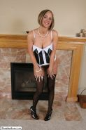 Desirae Spencer takes off nice corset lingerie and posing in hold-ups and heels