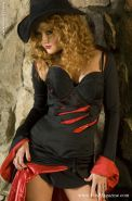 Hot MILF in halloween outfit Audrey Hollander uncovering her tempting curves