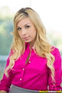 Tattooed blonde office babe Carmen Caliente in high heels and strips