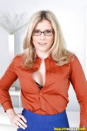 Glasses wearing MILF Cory Chase revealing big boobs while undressing