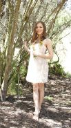 Pretty teen babe Avril Sun uncovering her graceful curves outdoor