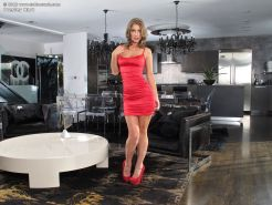 Bare legged Presley Hart strips red dress & black panties for masturbation