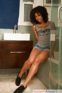 Ebony babe Misty Stone strips off denim shorts and exposes tiny boobs
