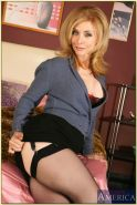Busty mature Nina Hartley demonstrates her goodies in stockings