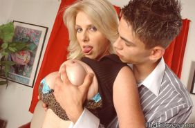 Mature blonde Penny Porsche denudes huge puffy tits and fucks hard