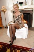 Mature lassie in sexy pantyhose taking off her dress and toying her cunt