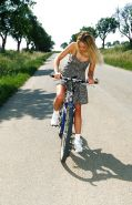 Close up outdoor posing featuring teen babe Zuzana G on a bike
