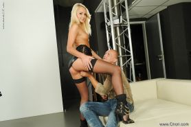 Beautiful blond pornstar Ivana Sugar stroking one cock while riding another