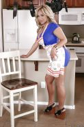 Buxom blonde housewife Olivia Austin Posing in dress and platform shoes