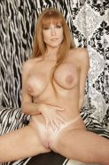Mature redhead Darla Crane teases her big tits and pussy in high heels