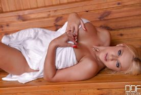 Big boobed blonde Dolly Fox inserting vibrator into snatch in the sauna