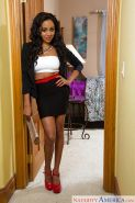 Slim black girl Anya Ivy poses in business clothes after work