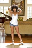 Ebony babe with a tight ass Misty Stone gets completely naked