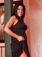 Busty mature gal Kendra Secrets getting rid of her dress and sexy lingerie
