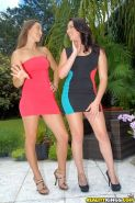Stunning hotties in tiny dresses make some lesbian humping action outdoor