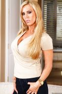 Curvy blonde MILF Amber Lynn stripping and spreading her legs