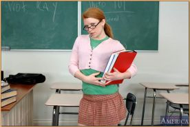Tempting college redhead in glasses Madison Young strips in class