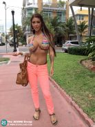 Fully clothed erotic beauty Brook Ultra flaunts huge breasts outdoors