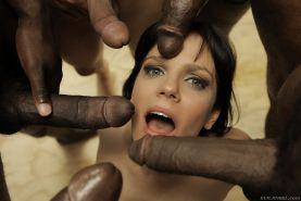 Bobbi Starr gets her face covered with cum after interracial blowbang