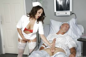 Stocking attired nurse Lily Love baring big boobs while giving handjob