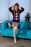 Blonde amateur Meet Madden freeing bare legs from white stockings